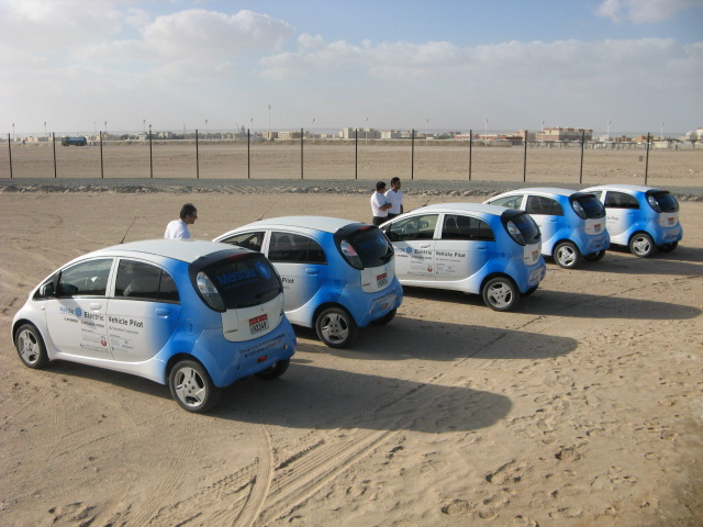 Mitsubishi i electric cars at Masdar City 10 MW solar power plant. Credit: Marika Krakowiak / ZacharyShahan.com.