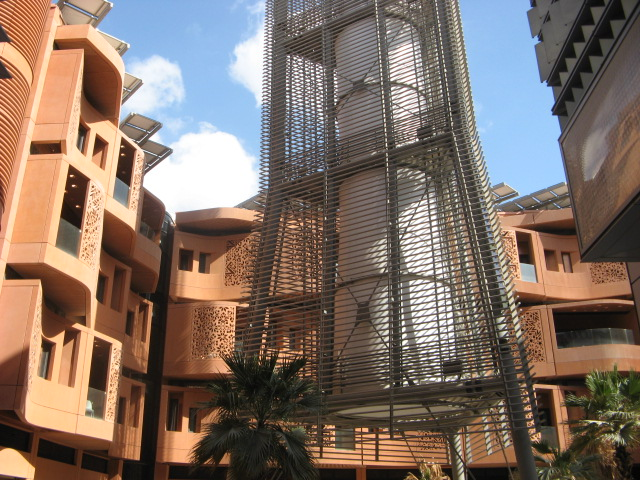 Another Masdar City courtyard, this one with a wind tower that helps to cool the area. Credit: Zachary Shahan.